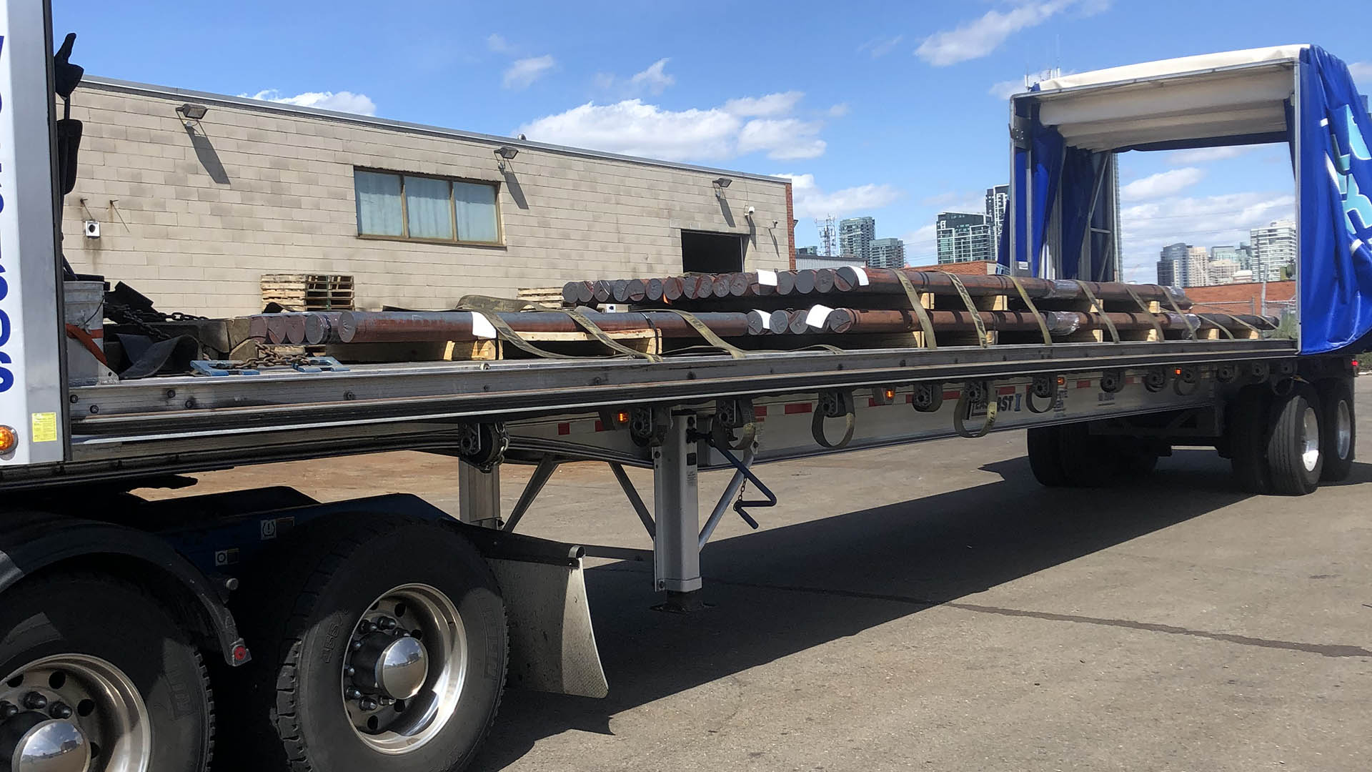Flatbed with round stock loaded for delivery